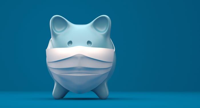 Piggy bank wearing a face mask.