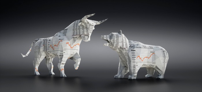Paper bull and bear made out of the stock market section of the newspaper.