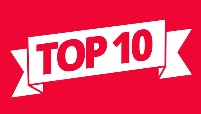 The words TOP 10 in red on a white ribbon against a red background.