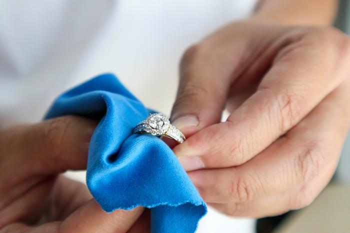 Man polishing diamond ring