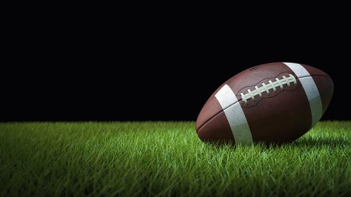 A football on a grass field.