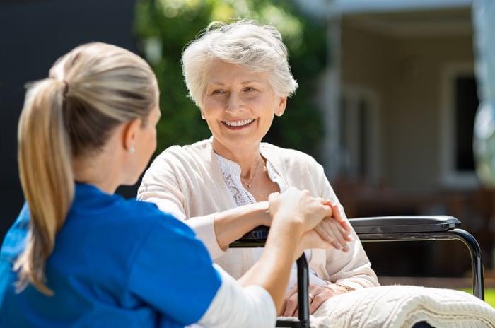 Caregiver and elderly patient.