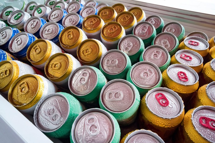 Chilled beverages in rows of aluminum cans.
