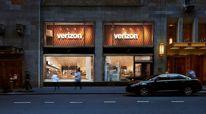 Exterior of a Verizon retail store at night