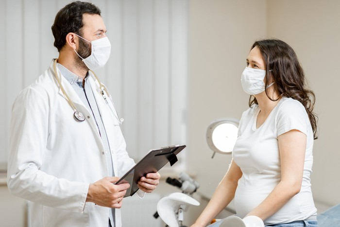 Doctor and patient in face masks