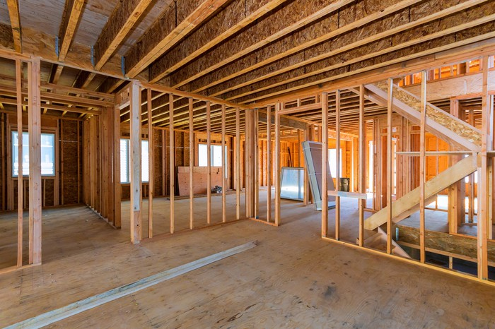 The wood-frame interior of a home under construction.