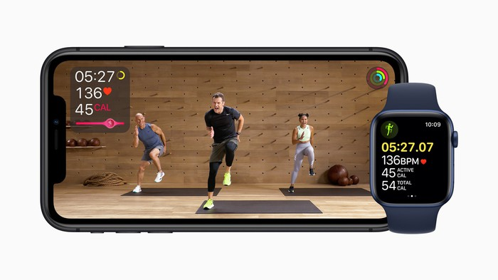 Apple Watch and iPhone displaying Apple Fitness+ interfaces