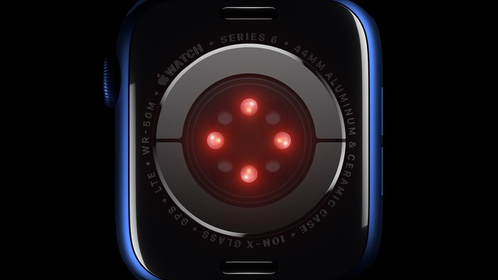 Close-up of the SpO2 sensor on the back of a blue Apple Watch