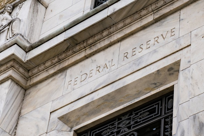 Entrance to Federal Reserve Bank, with words Federal Reserve engraved above.
