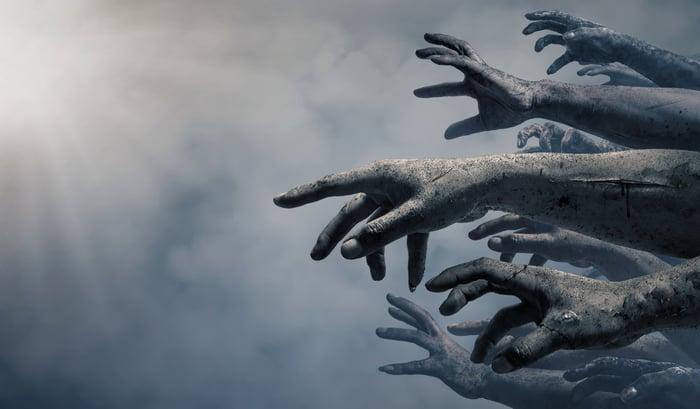 Zombie hands reaching forward.