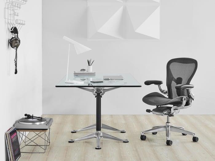 The Herman Miller Aeron chair next to desk.