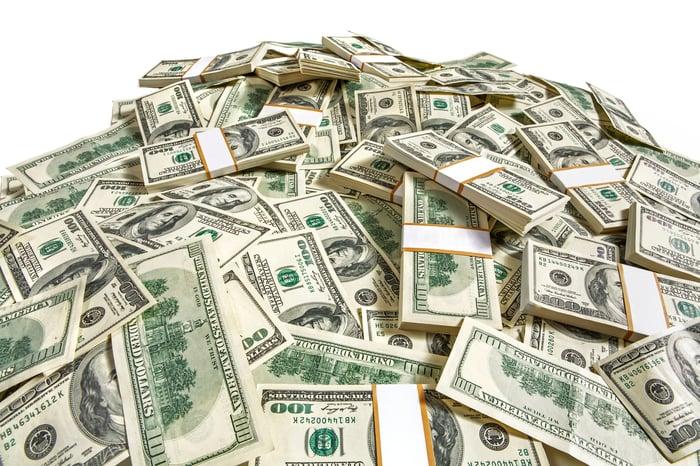 Pile of bundles of hundred dollar bills.