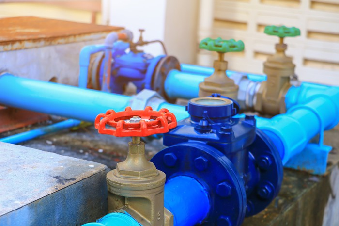 Water pipes and valves in a building.
