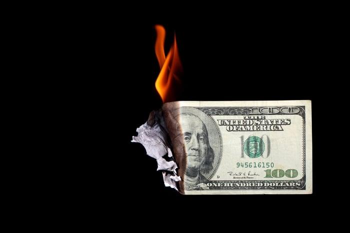 Dollar bill on fire