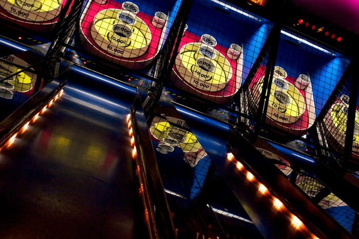 Skee ball in an amusement facility.