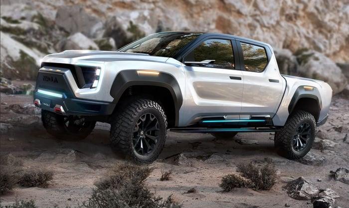 Nikola Badger pickup truck in gray, in a desert landscape.