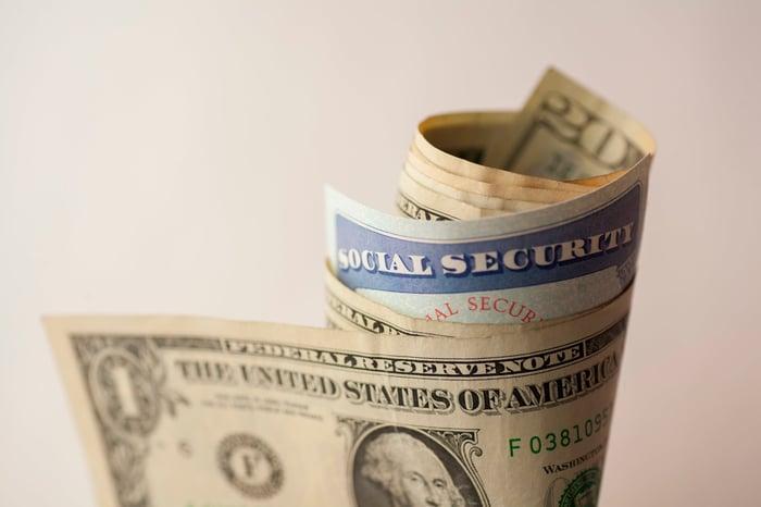 Social Security card folded into a money roll.
