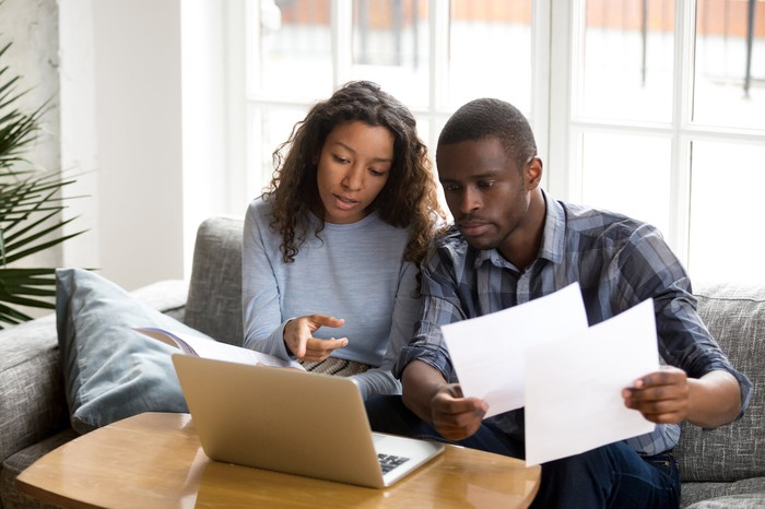 Couple reviewing finances together at home.