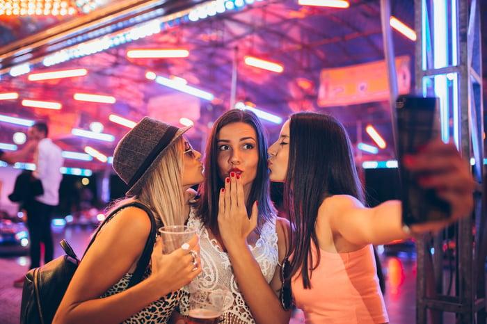 Three women take a selfie.