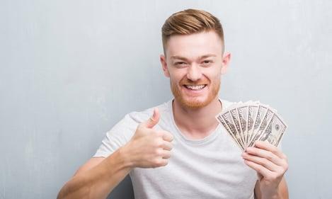 Man holding money 2