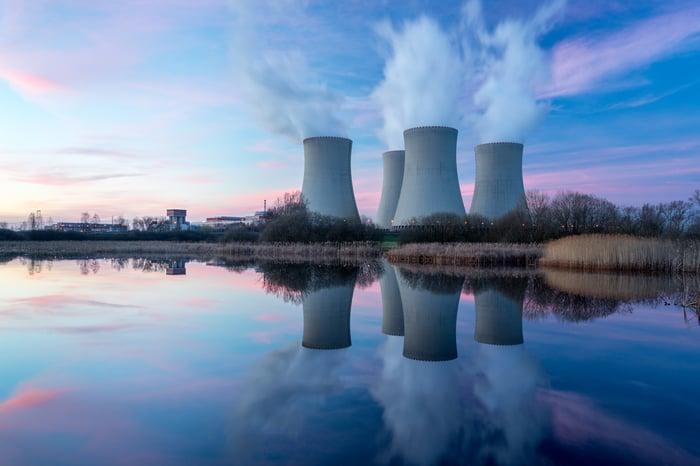 A nuclear power plant at dusk.