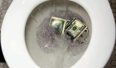 Flushing $100 bills down the toilet