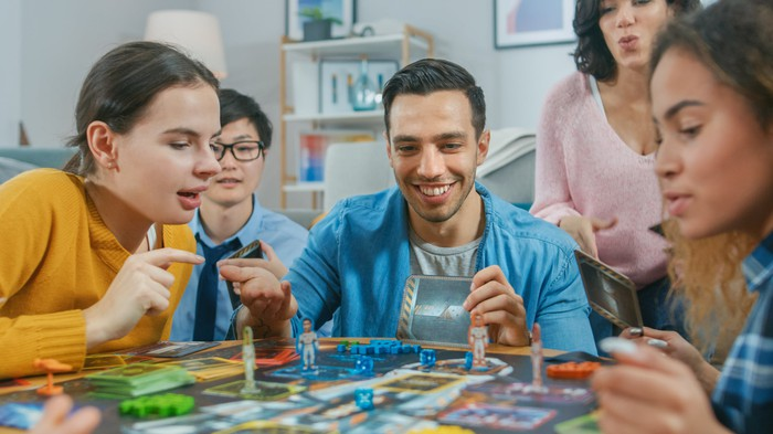 Diverse group of people playing a board game.