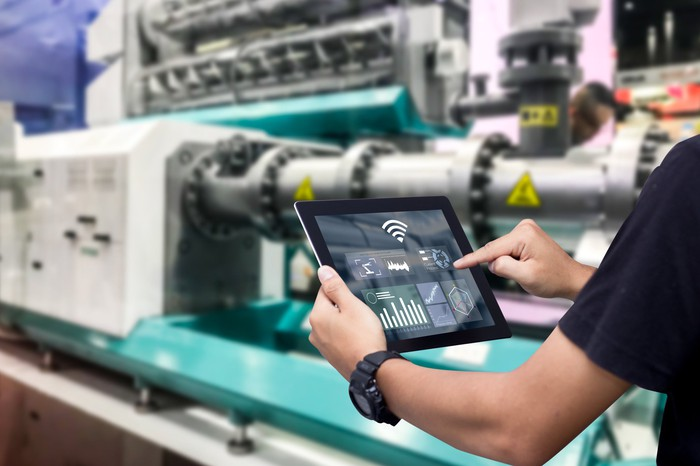 Someone using tablet in industrial setting