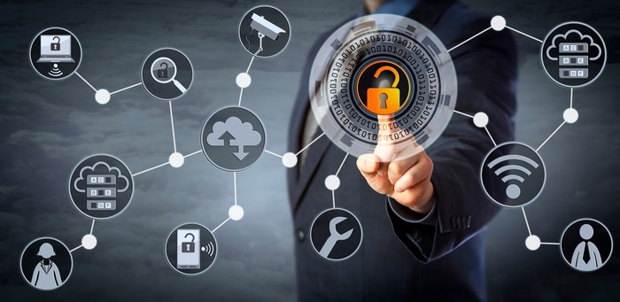 Man is unlocking a virtual locking mechanism to access shared cloud resources.