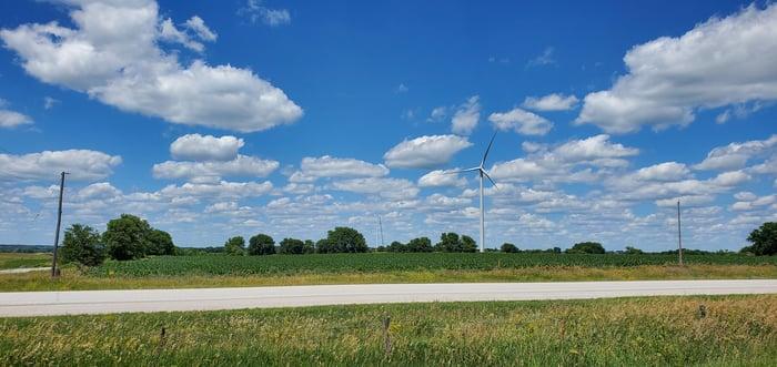 A GE wind turbine in a field