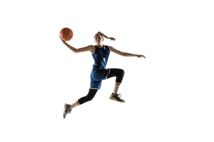 A basketball player in midair.