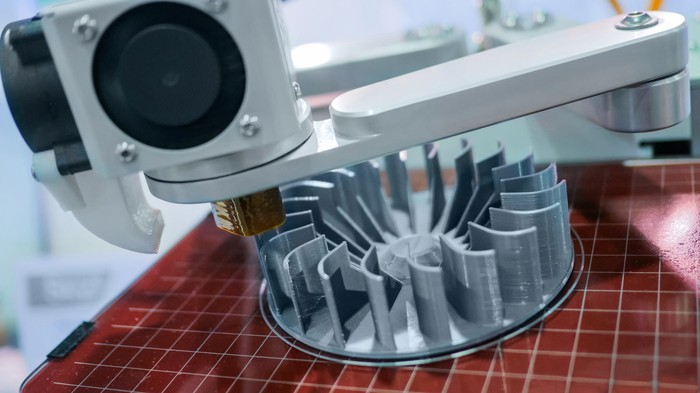 A 3D printer in the process of printing a complicated turbine part.