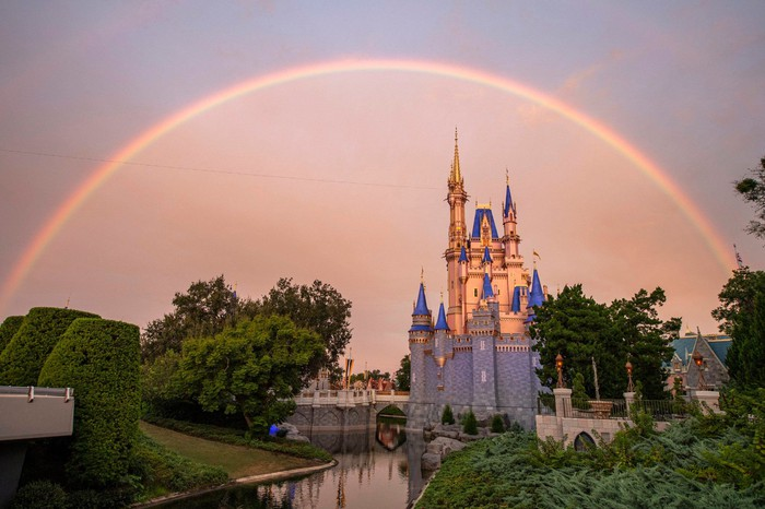 A view of the Magic Kingdom Cinderella's Castle with a rainbow in the background