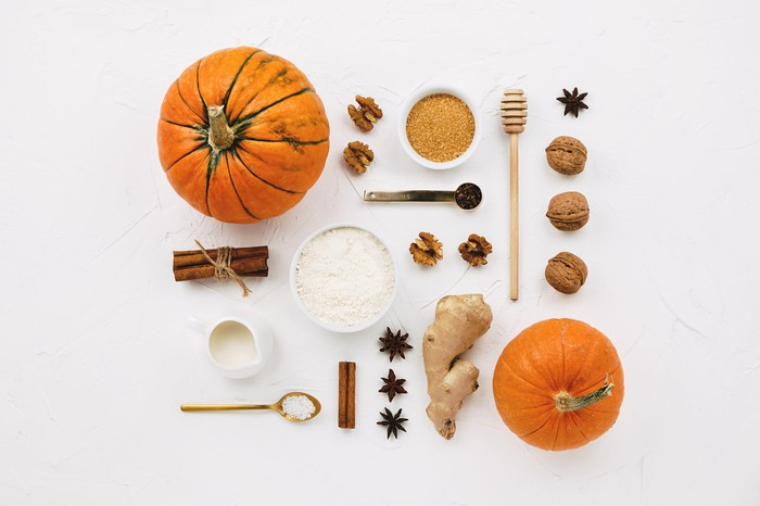 A top-down view of all the ingredients laid out for pumpkin spice.