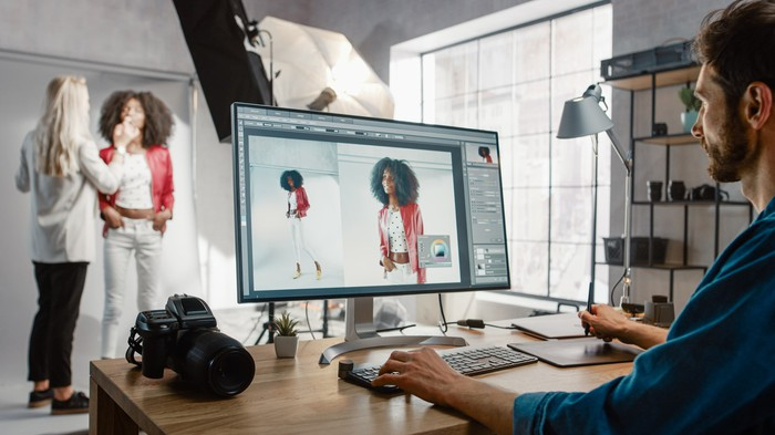person editing a photo on a computer