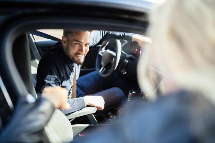 Smiling car driver