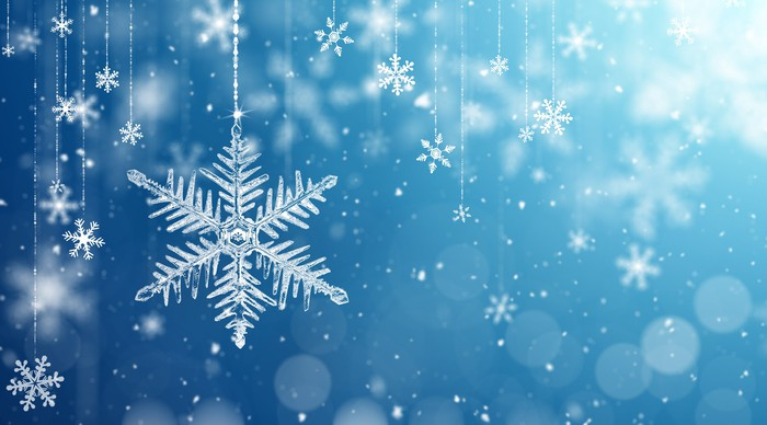 Falling snowflakes on a blue background.