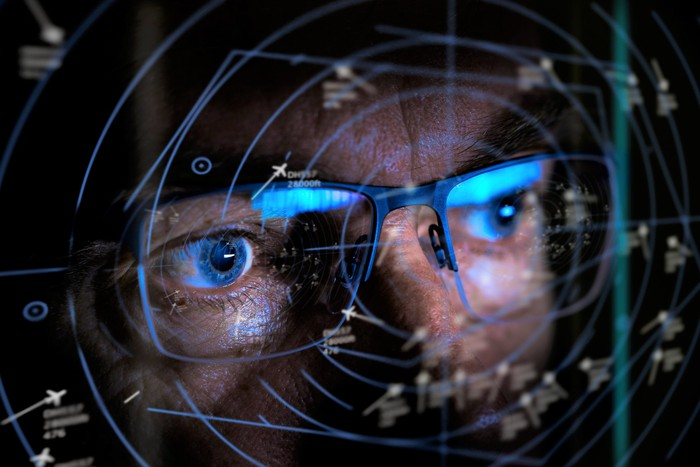 Close-up of person looking into a radar screen.