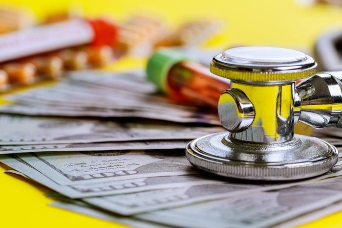 Stethoscope and money.