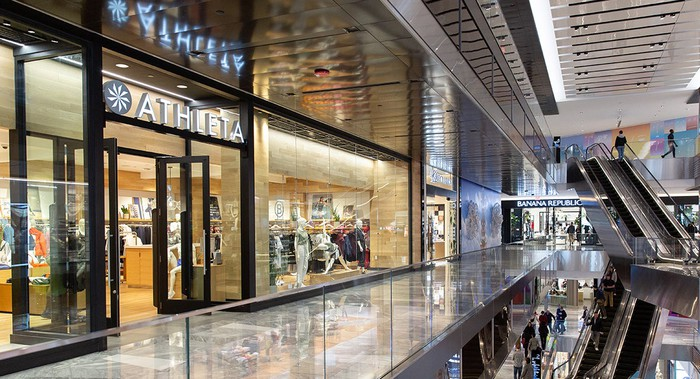 An Athleta storefront in a mall