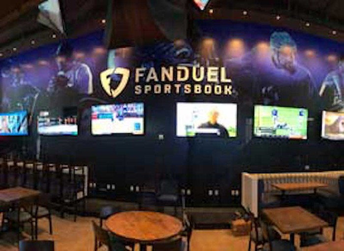 FanDuel logo and TVs showing sports in casino