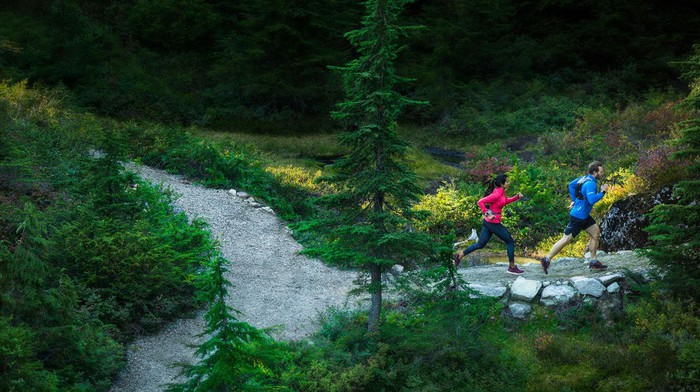 Two outdoor trail runners in the mountains