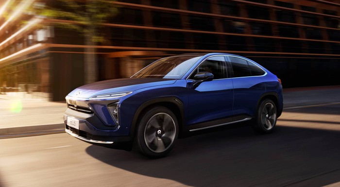 A blue NIO EC6, a sleek upscale electric crossover SUV with a coupe-like roofline.