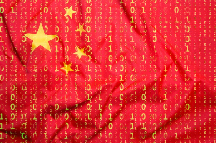 Chinese flag overlaid with binary code.