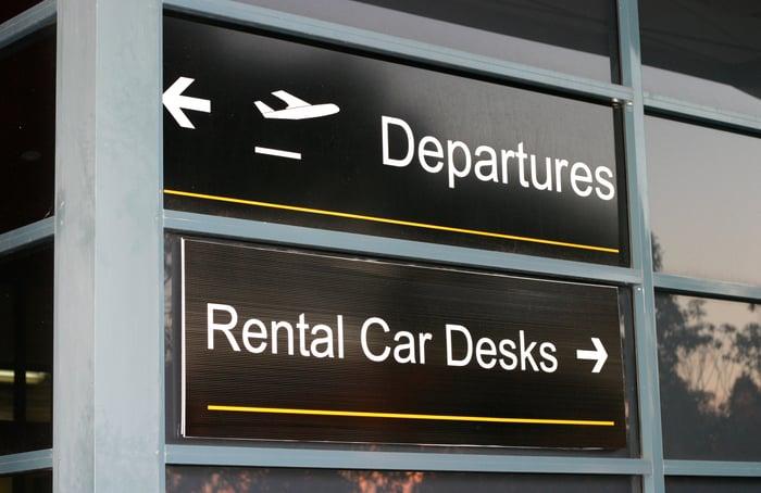 rental car desk sign at airport.