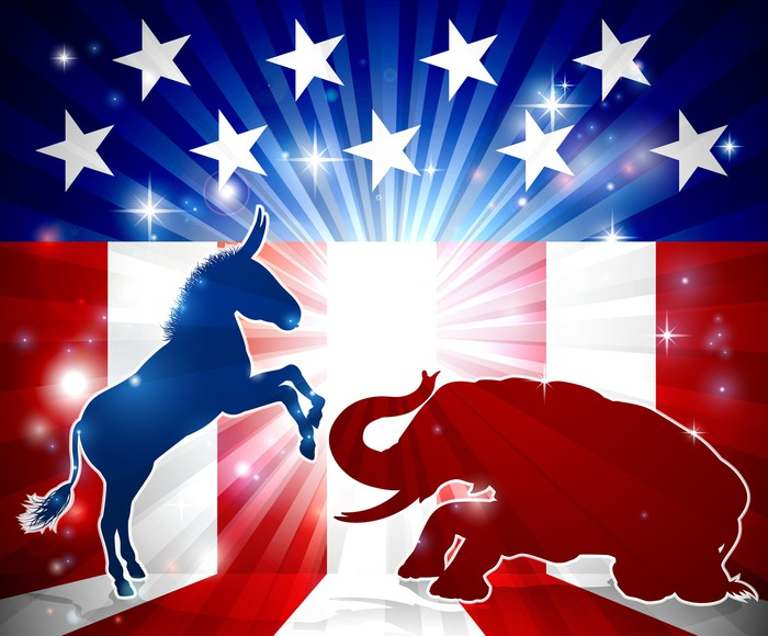 Democratic donkey and Republican elephant clash in front of an American flag  themed background.