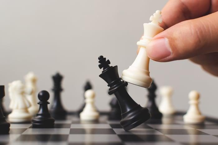 White king knocking off black king in Chess.