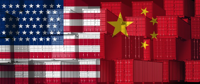 Cargo freight containers painted with the American and Chinese flags.