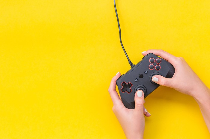 A person holding a video game controller.