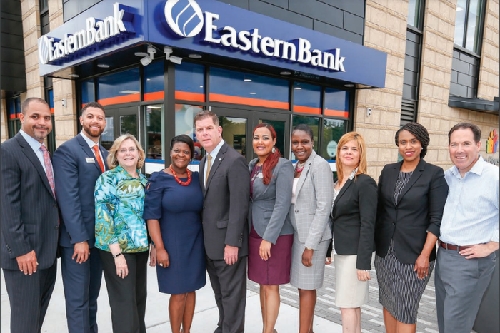 Eastern Bank team members stand together in front of a branch office.